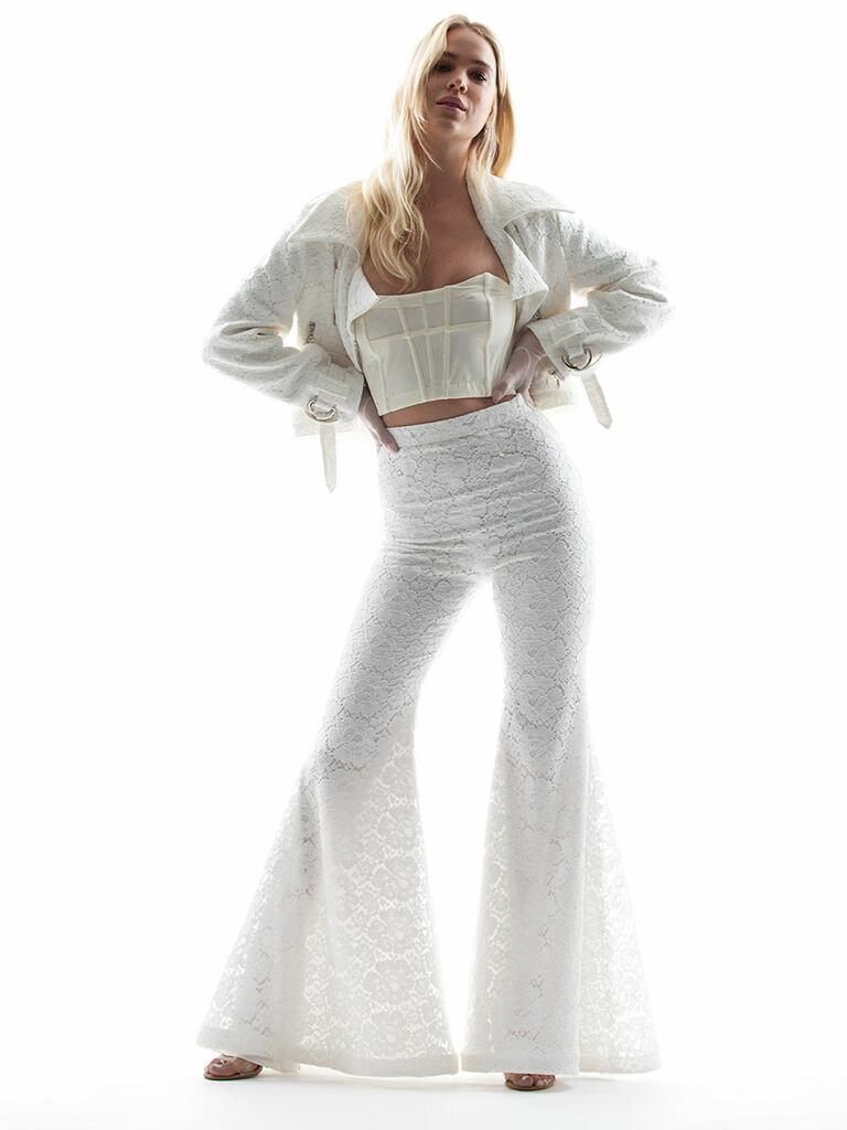 Houghton Spring/Summer 2018 white eyelet jacket and high waisted bell bottom pants set with bustier crop top