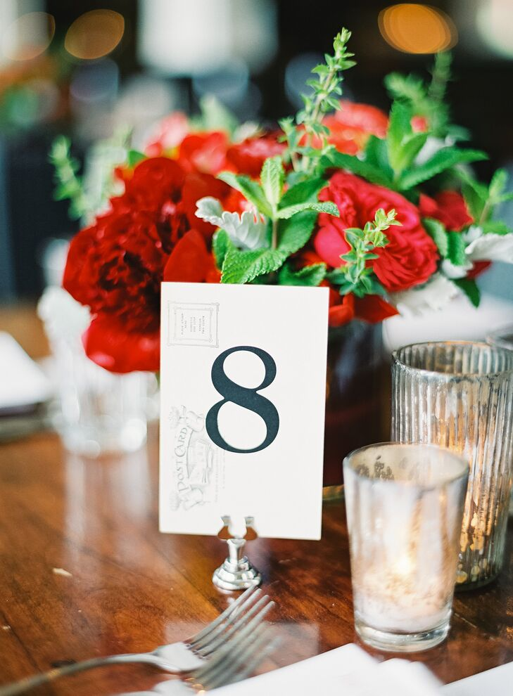 Simple white and black table numbers were displayed on wood dining tables at the Presidio Social Club venue.