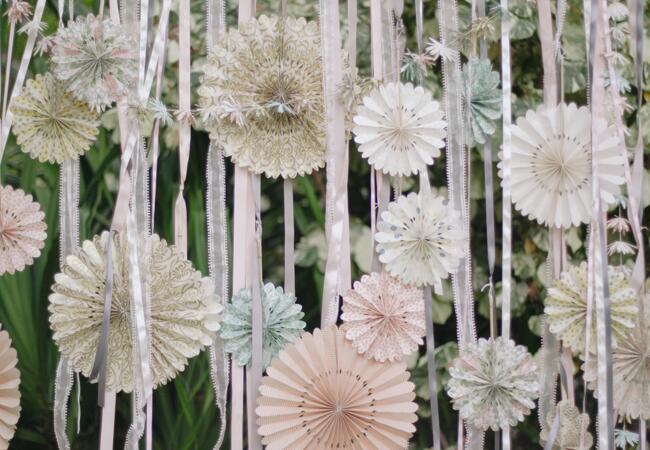 diy paper flower ceremony backdrop   Cristina Elena Photography   Blog.theknot.com