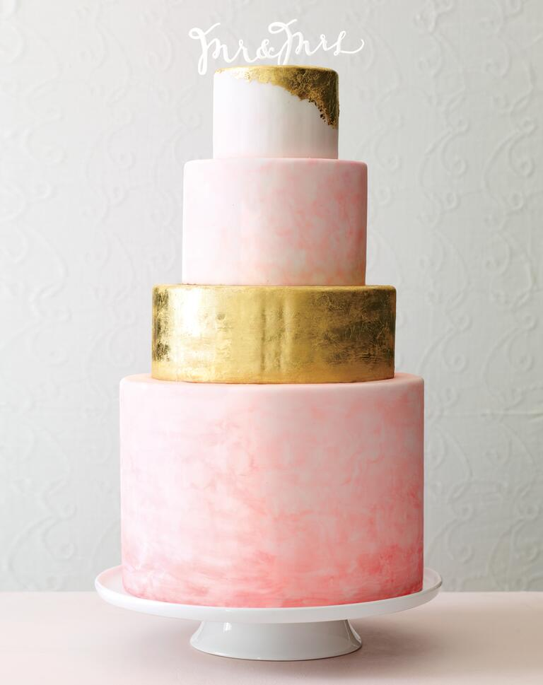 Pink watercolor and gold foil wedding cake design