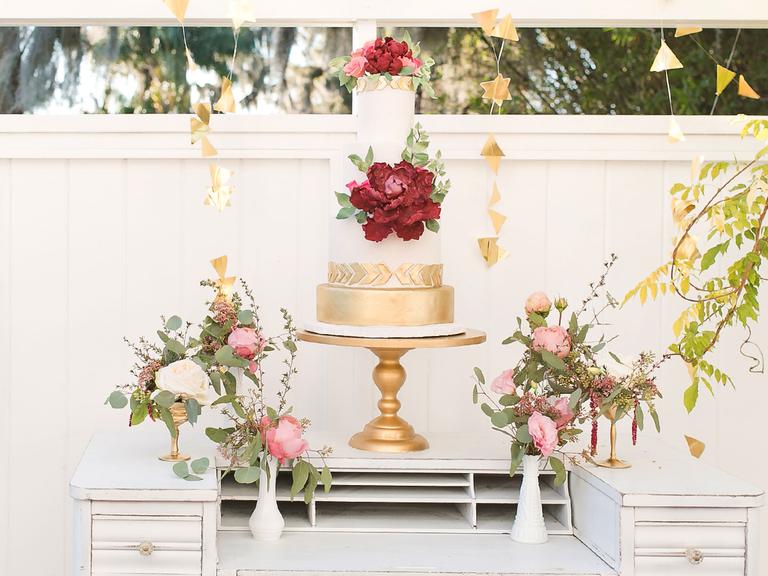 Boho gold and white wedding cake with sugar flower peony