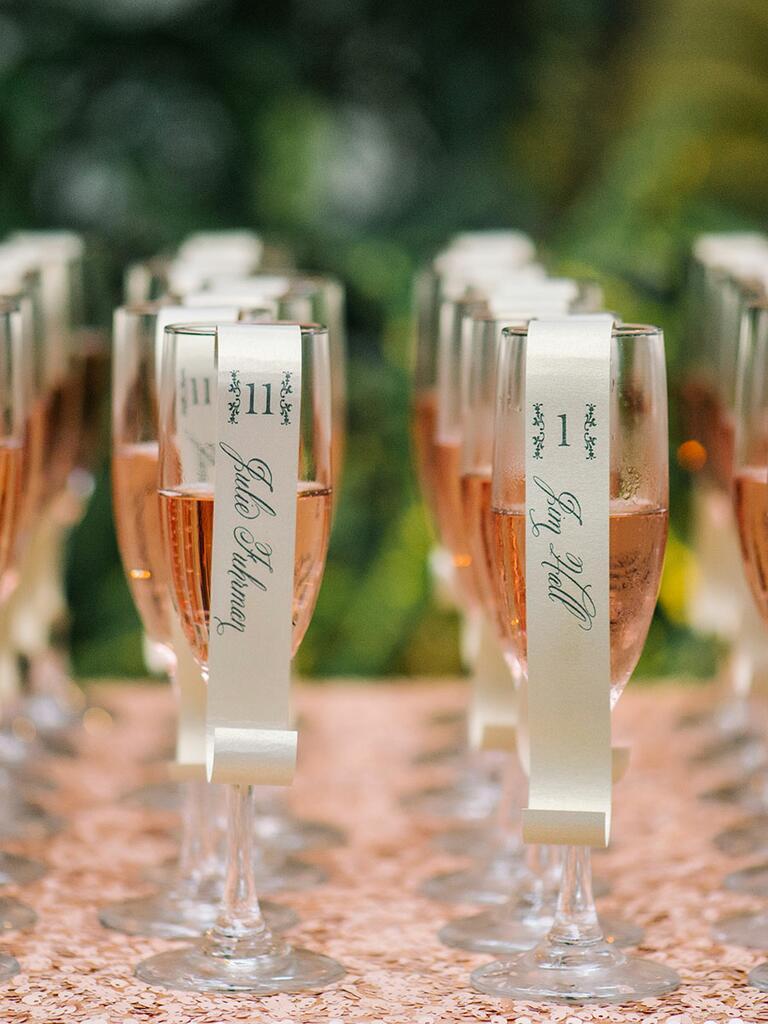 Cute champagne flute escort card idea
