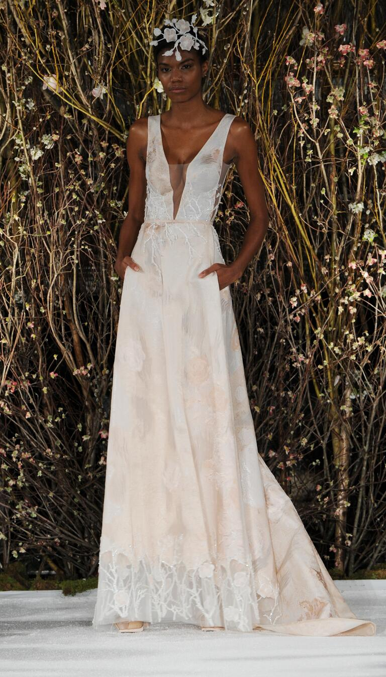 mira zwillinger wedding dresses bridal fashion week spring plunge wedding dress Mira Zwillinger Spring sleeveless wedding dress with blush floral detail and plunging illusion neckline