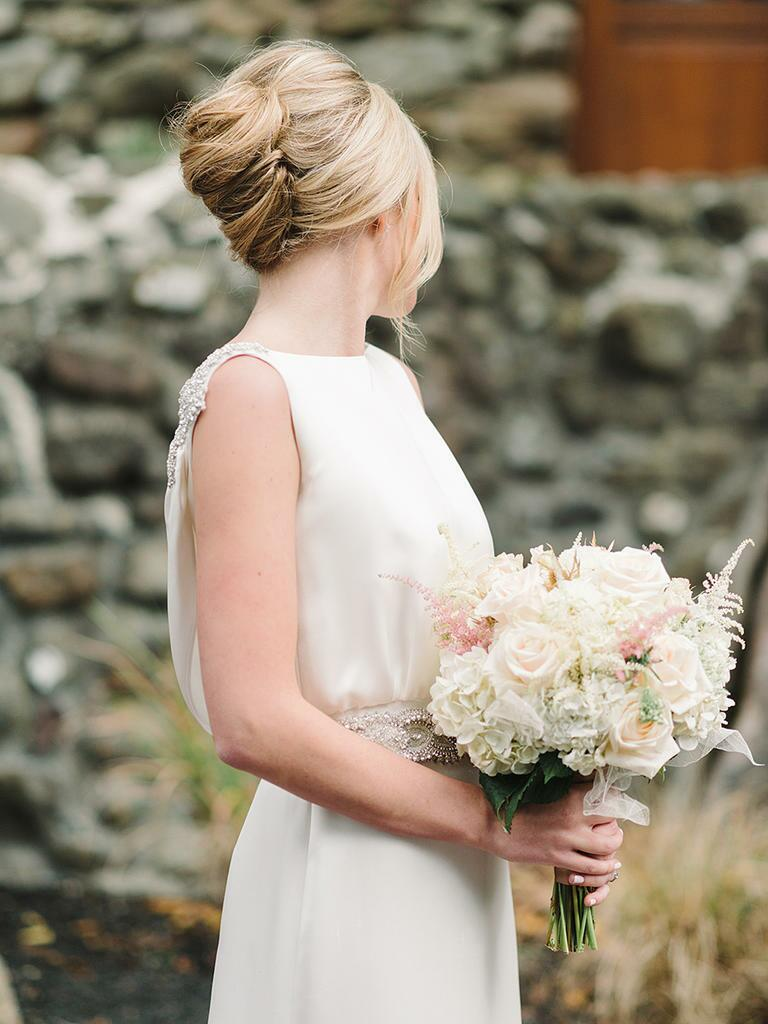 Bride with a French chignon twist updo