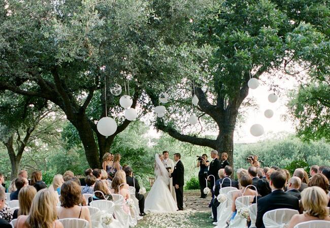 Woodland wedding ceremony backdrop: Q Weddings / TheKnot.com