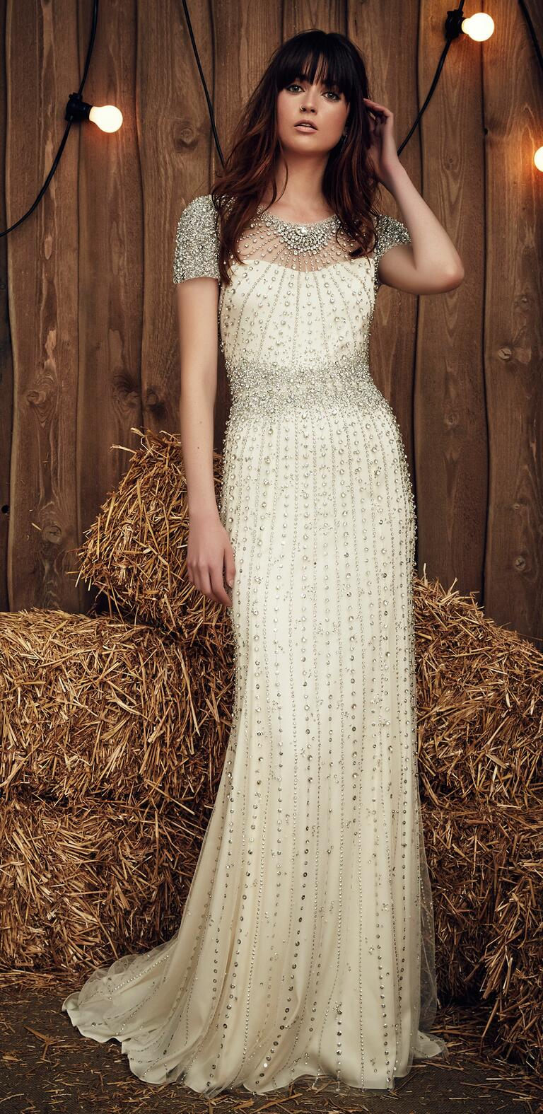 jenny packham wedding dresses bridal fashion week spring wedding dresses dallas Jenny Packham Spring Dallas gown with heavy crystal embellishment on the illusion neckline and sleeves