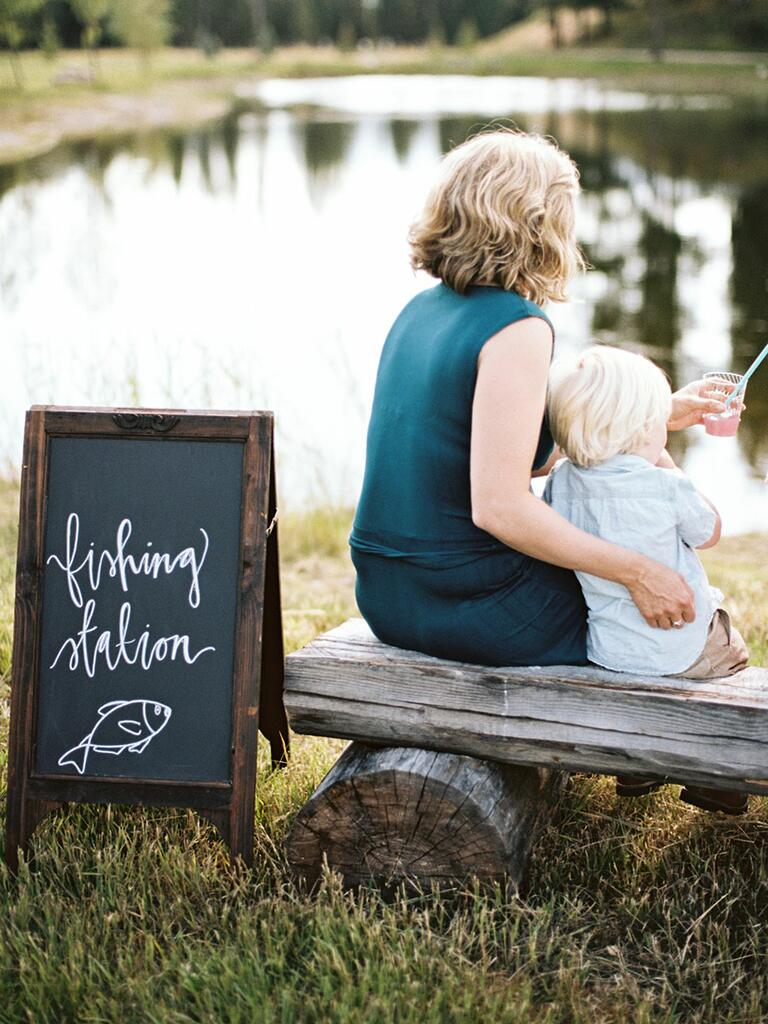 camp wedding chalkboard sign and wooden bench