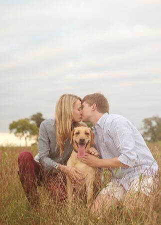 Engagement Photos with Dogs: Amie Reinholz / TheKnot.com