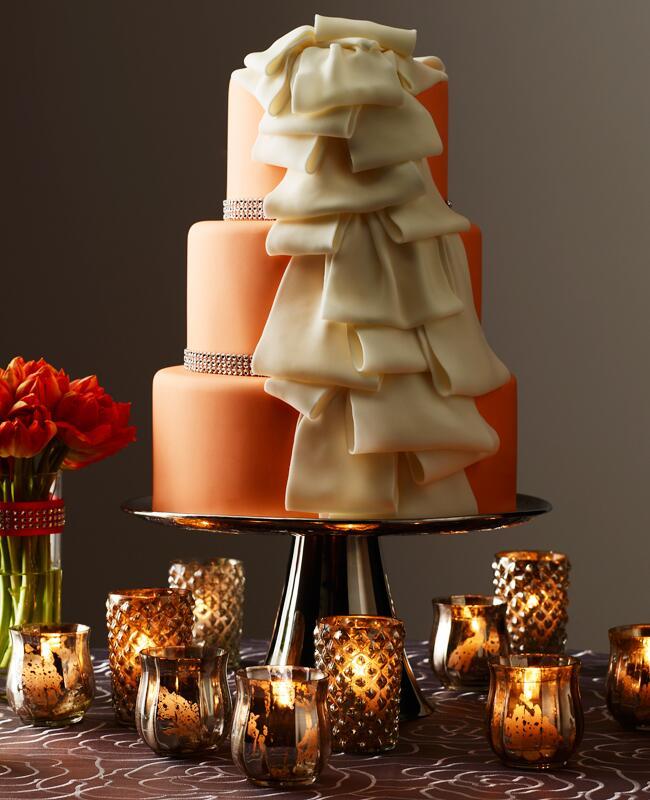 Cascading fondant ribbon orange wedding cake | David Prince | blog.theknot.com
