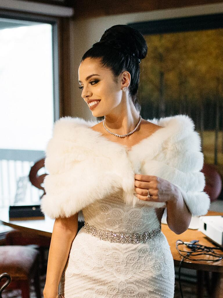 bride wearing fur cover-up