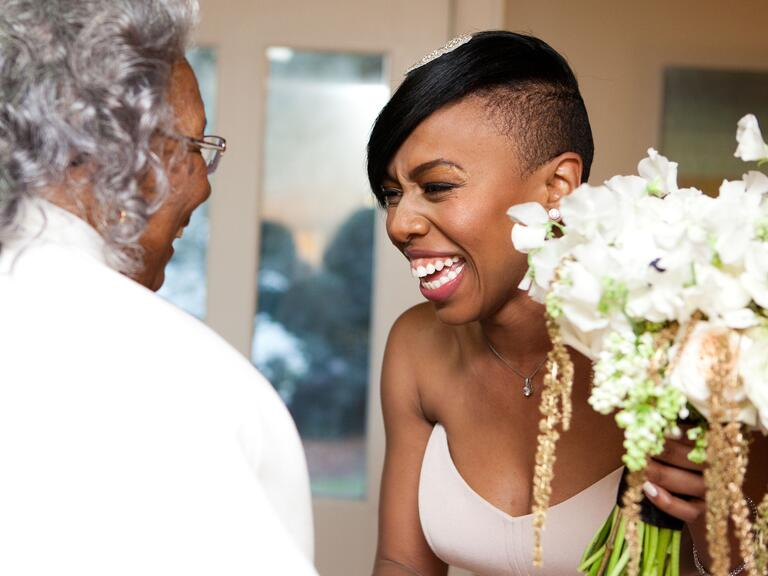Excited bride with bouquet on wedding day
