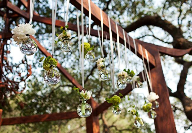 Hanging glass globe wedding decor: Eclectic Images / TheKnot.com