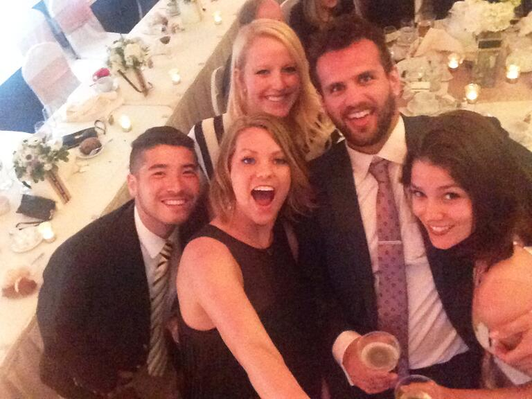 Selfie stick picture of guests at a wedding