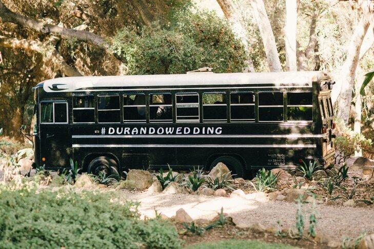 Black bus with social media hashtag