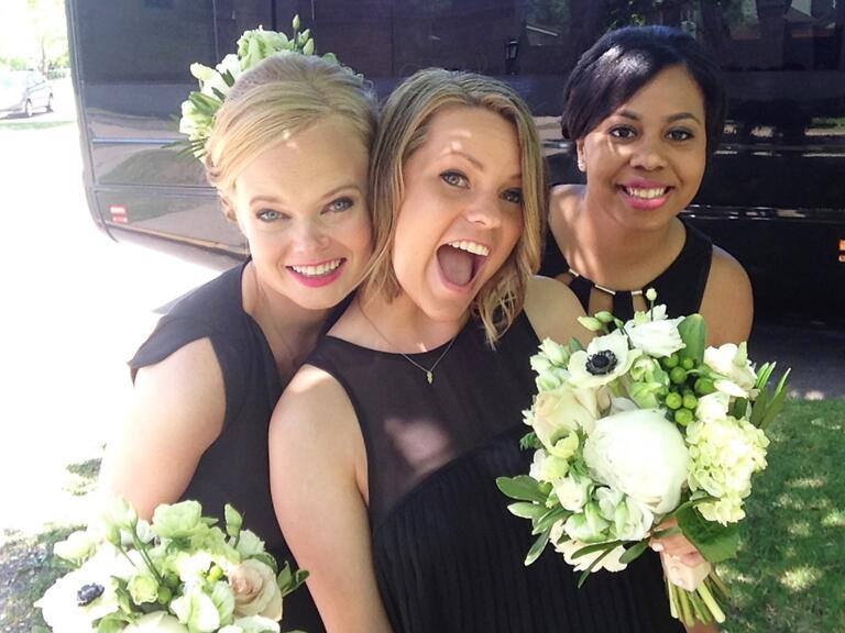 Bridesmaids taking a selfie stick picture