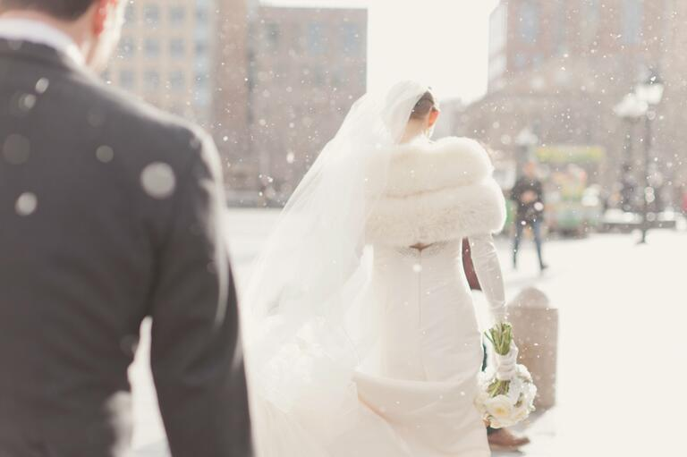 Bride wearing a fur stole and a cathedral veil