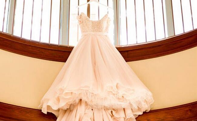 Blush Wedding Dress Jessa Duggar : Dress hanging from a staircase to show how flowy her ball gown was