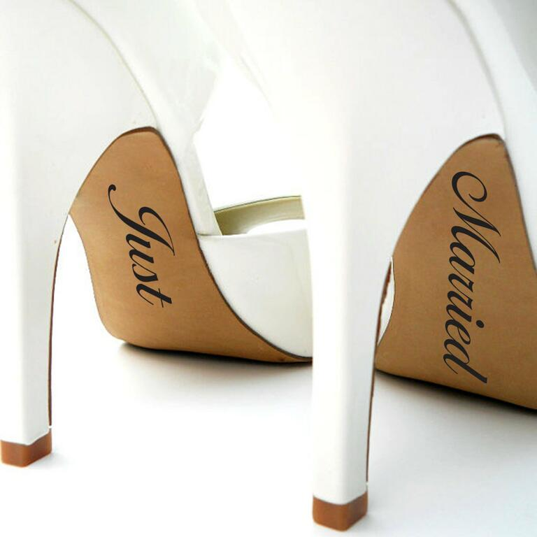 just married decals on white wedding shoes