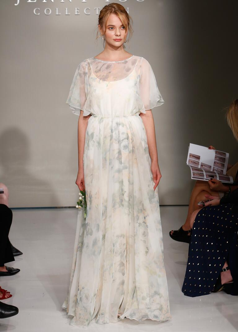 Jenny Yoo Fall 2016 wedding dress with sheer winged sleeves and sheer high neck with flowing skirt in blush and grey pattern
