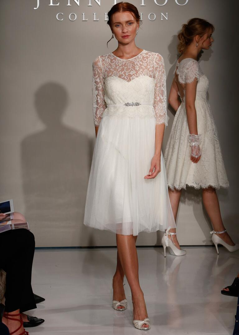 Jenny Yoo Fall 2016 tea length wedding dress with sheer lace neck and 3/4 sleeves, sweetheart neckline and beaded belt and tulle skirt