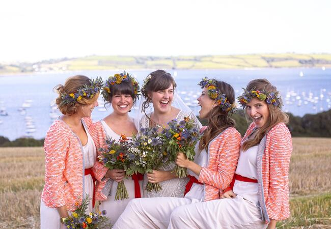 Bridesmaids wearing flower crowns: Joseph Hall / TheKnot.com