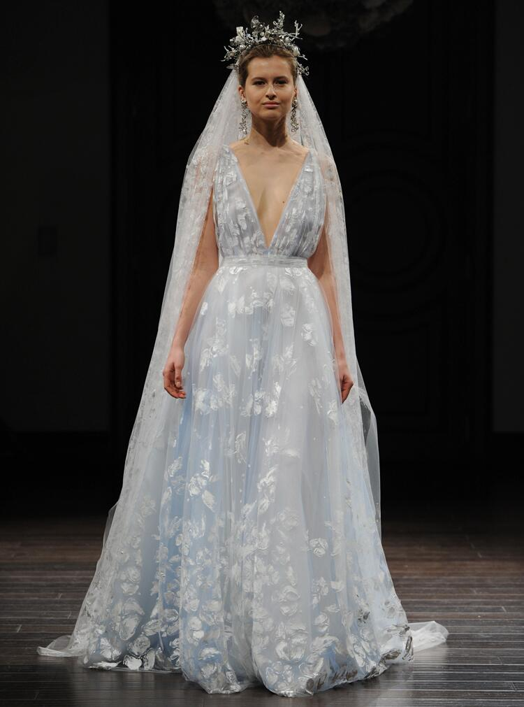 Naeem khan 39 s intricate designs hit bridal fashion week for Painted on wedding dress