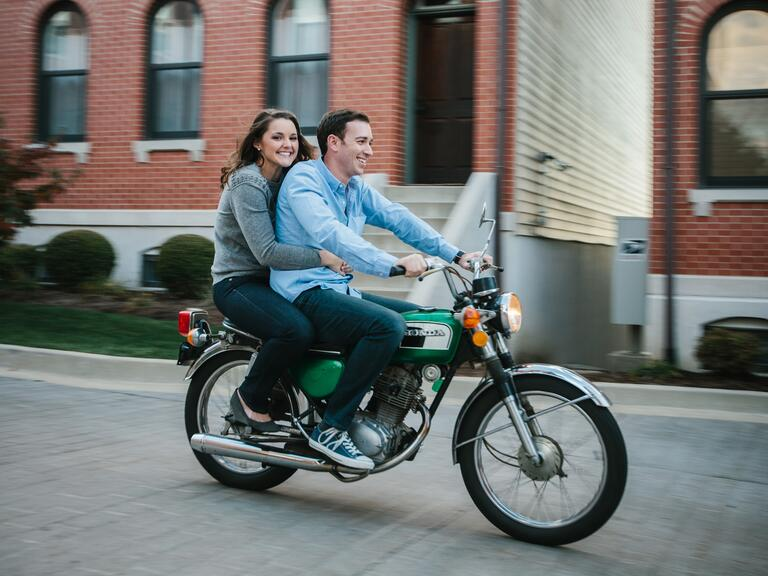 Newly engaged couple on Honda mini bike