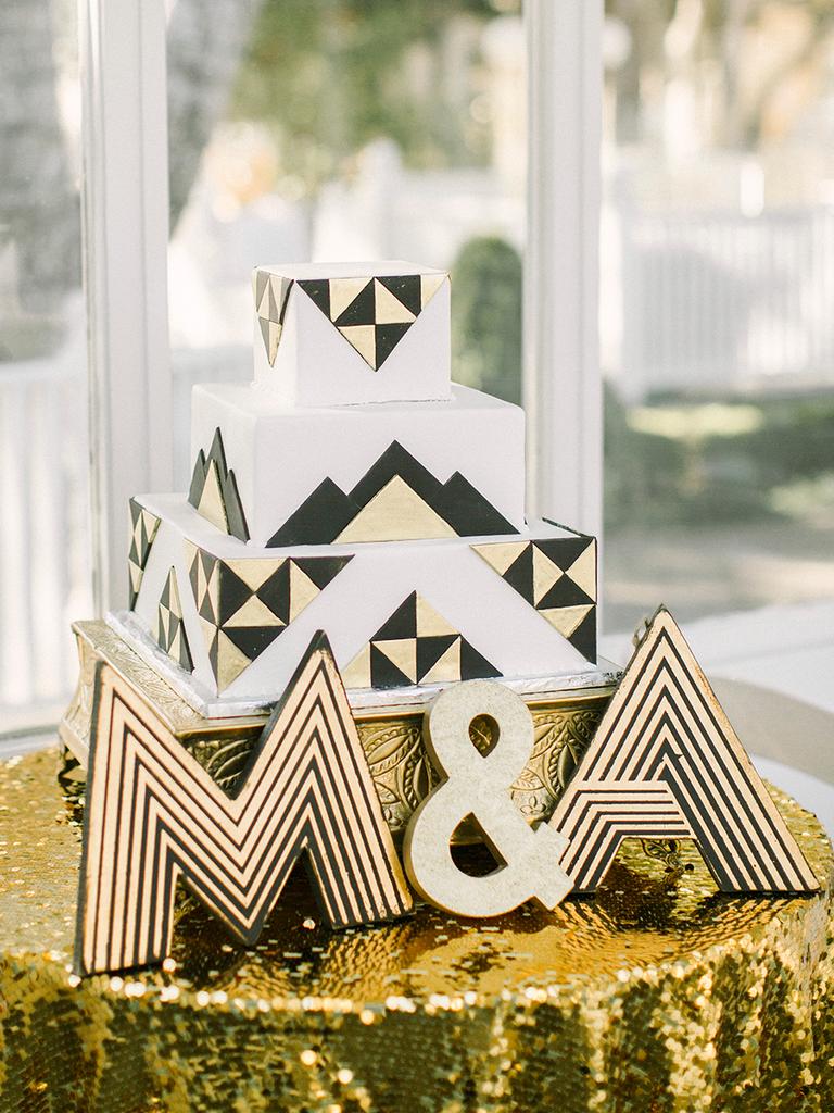 Art deco style gold and black wedding cake