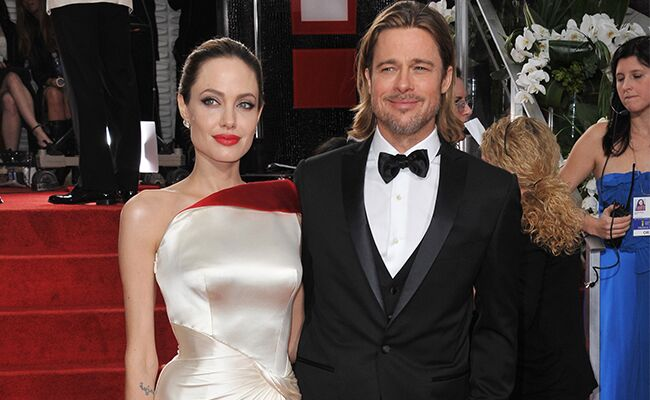 Angelina Jolie And Brad Pitt Pose On The Red Carpet