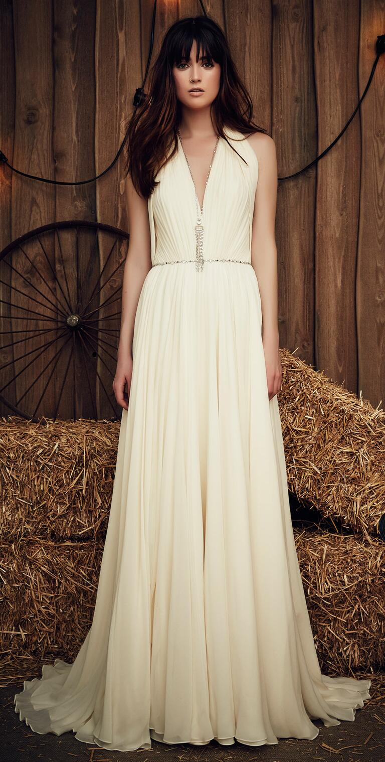 Jenny Packham Spring 2017 Daisy wedding dress in off-white silk with plunging halter neckline and nomad-inspired body jewelry accent