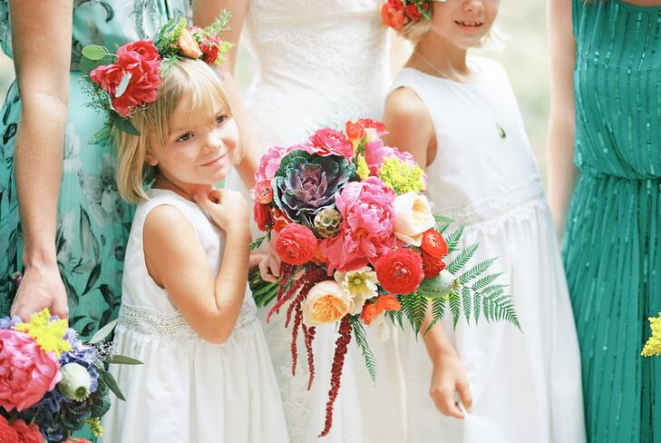 Flower girl holding the bridal bouquet