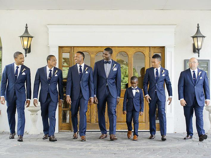 Groom and groomsmen in navy blue suits