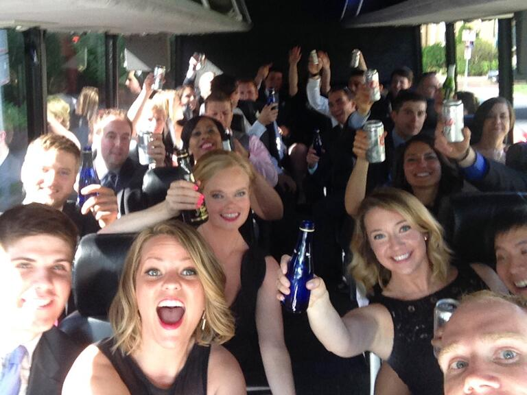 Selfie stick picture of a wedding party bus