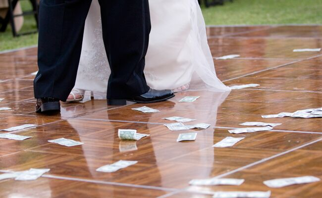 The Dollar Dance Wedding Etiquette Demystified — What You Need to Know  About Doing One 50aa292ebfb41