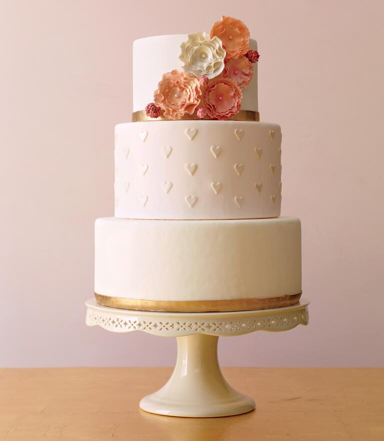 Simple wedding cake with flower accents and heart details