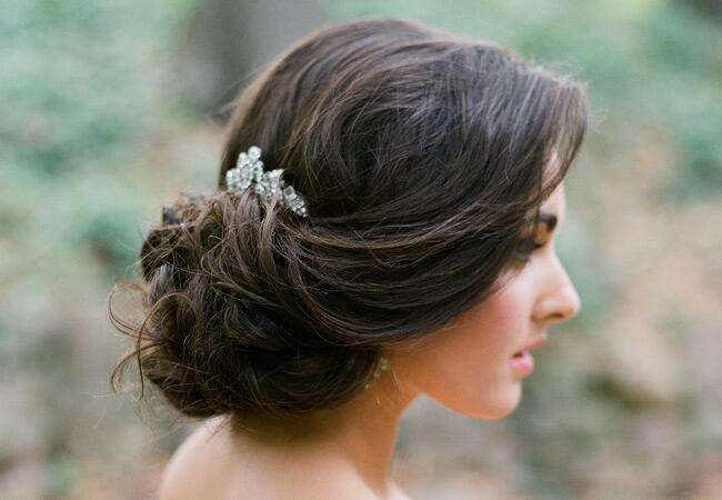 Low bridal updo with crystal hair accessory | Jose Villa | blog.theknot.com