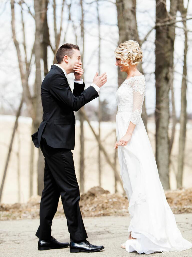Outdoor groom reaction first look photo idea