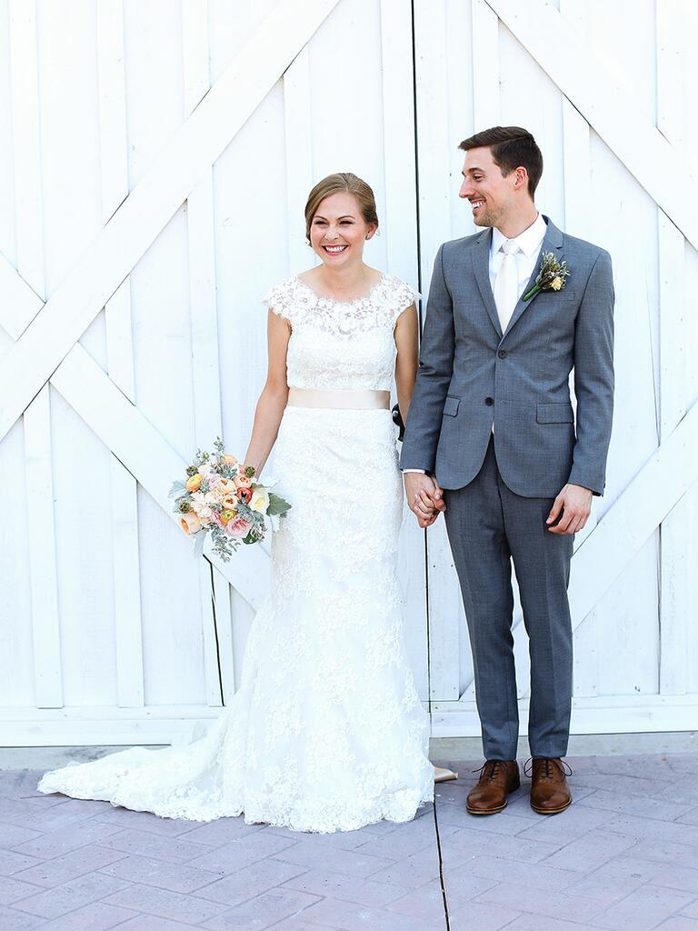 bride in lace wedding dress groom in gray suit