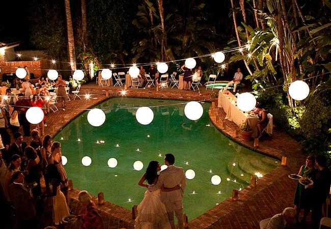 7 Places to Use String Bistro Lights at Your Wedding:5. Across the Pool at Your Reception,Lighting