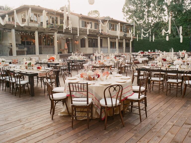 Outdoor wedding reception with white flower garland decor