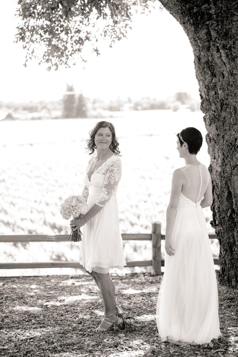 Brides first look at same-sex vineyard wedding