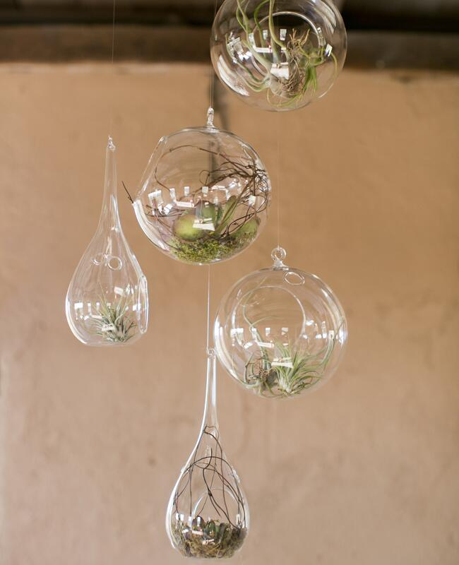 Hanging glass globe wedding decor: Mel & Co. / TheKnot.com