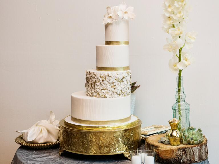 Gold leaf decorated staircase wedding cake