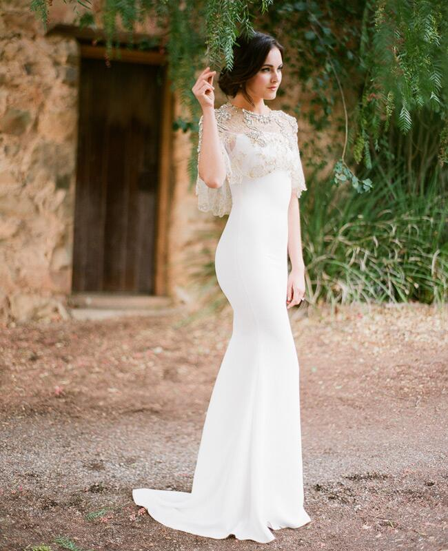 Badgley Mischka wedding dress with cape and Lulu Frost earrings | Jose Villa | blog.theknot.com