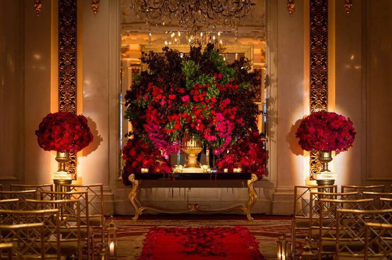 red floral ceremony altar
