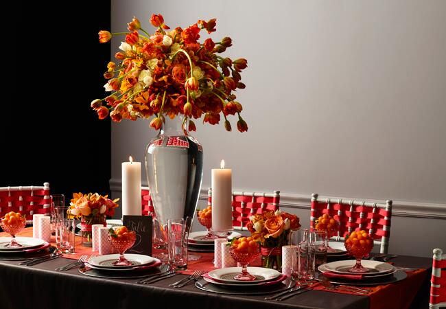 Tall reception centerpiece with orange roses, tulips and hydrangea | David Prince | blog.theknot.com