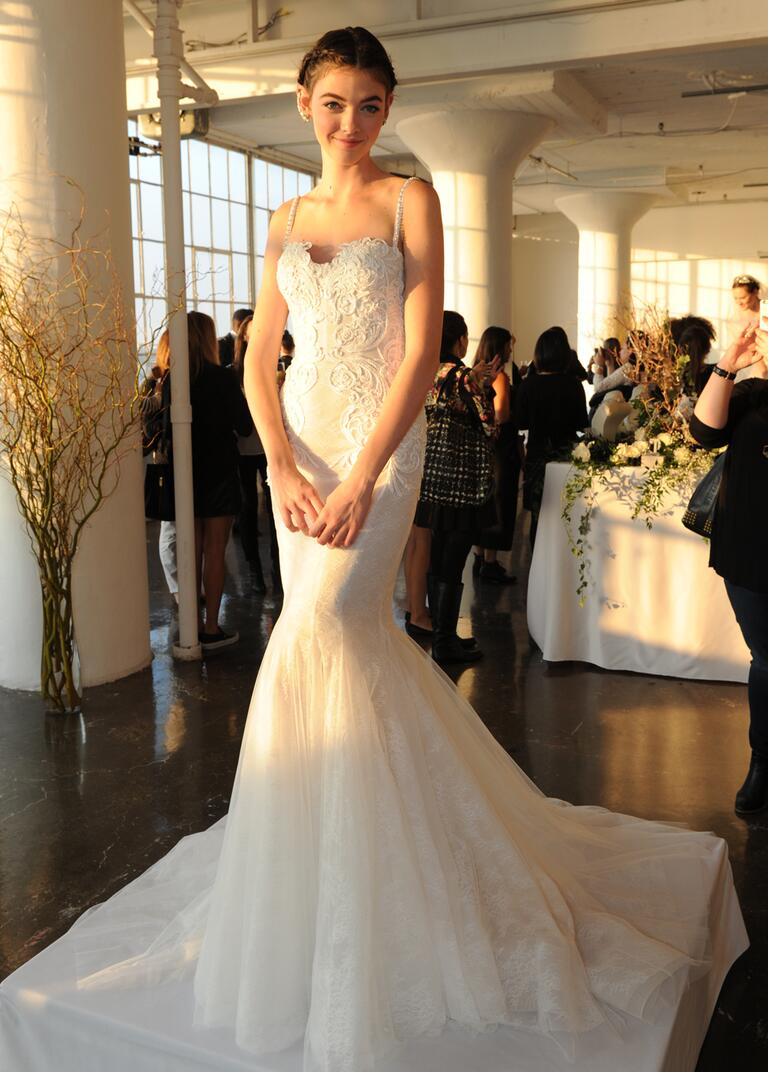 marchesa wedding dresses bridal fashion week fall wedding dresses Marchesa Fall mermaid wedding dress of lace and tulle with deep plunging back and seamed