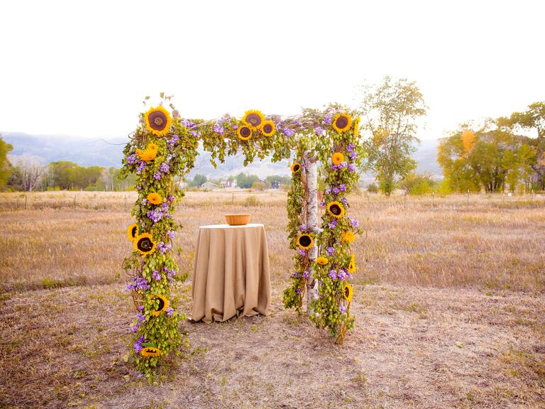 Sunflower decorated wedding ceremony arbor