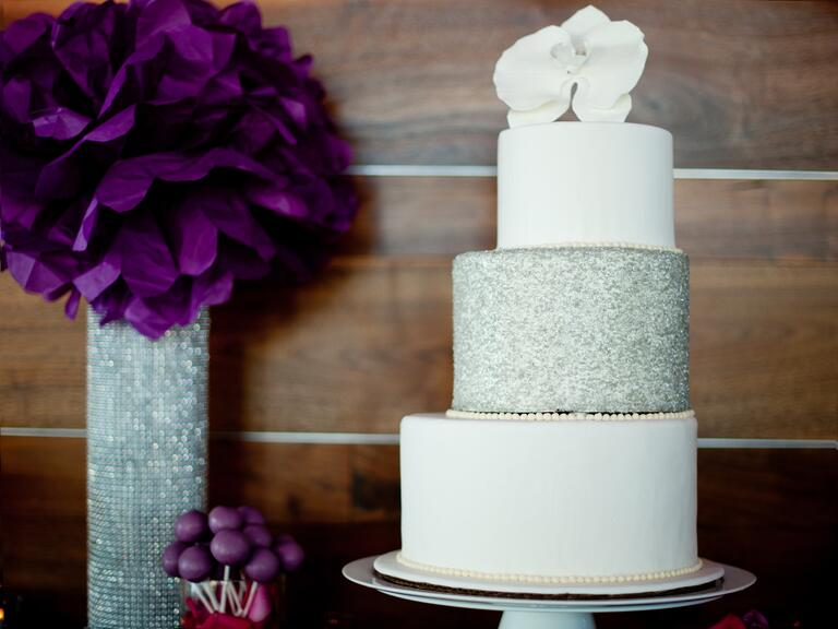 White staircase wedding cake with silver middle tier