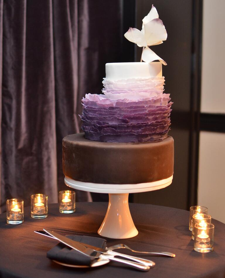 Staircase wedding cake with chocolate and purple ruffles